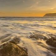 waves over rocks